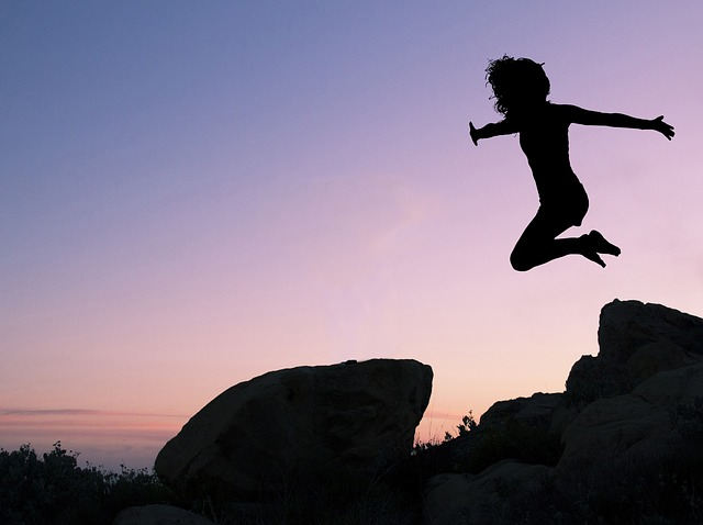 Girl leaping for her dreams